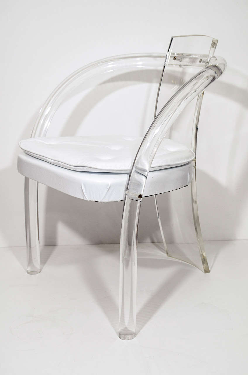 A pair of vintage lucite chairs with vinyl seats attributed to American furniture designer Charles Hollis Jones.  Jones is known for his pioneering work with Lucite. They are in good vintage condition with age appropriate wear; some scratches to