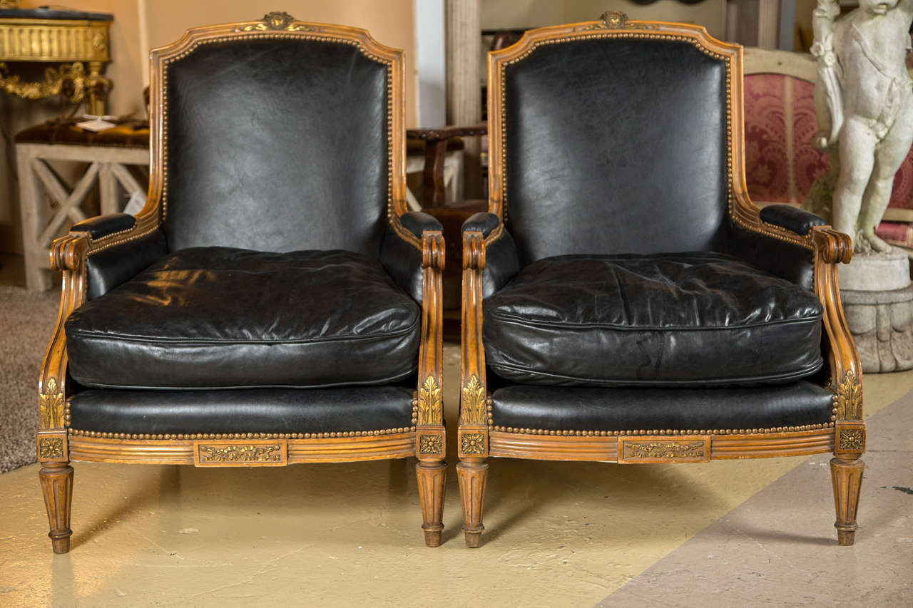 pair of louis xvi style worn leather bergere chairs attributed to