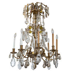 A Finely Cast Bronze and Crystal Eight Arm Chandelier