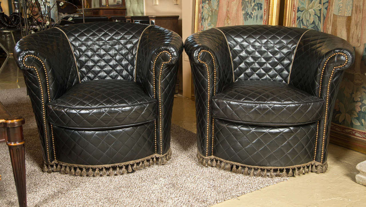 a group of four coco chanel styled barrel back leather