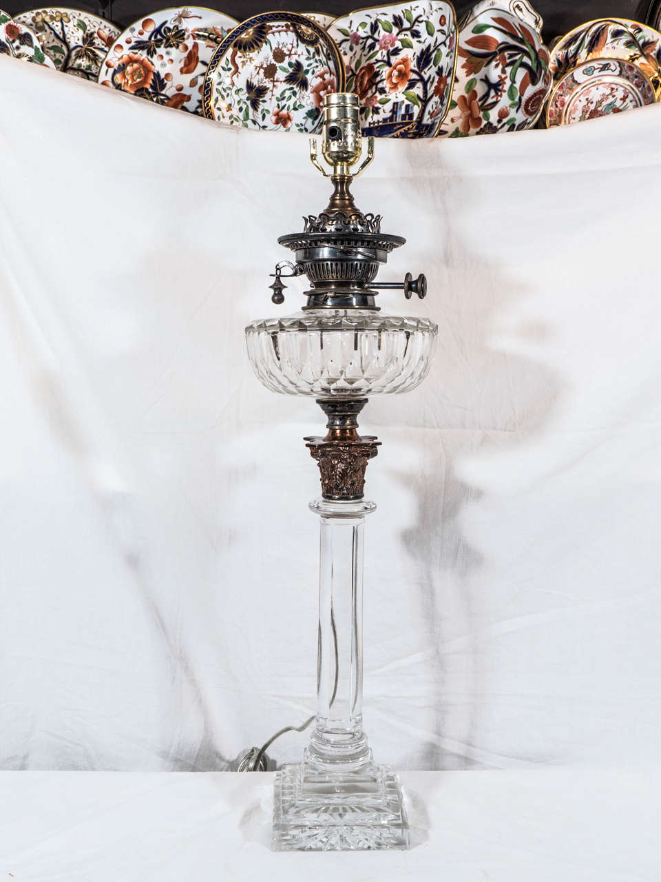 An elegant pair of tall neoclassical banquet lamps inspired by Greek columns. When decorating a room finding attractive lighting is not easy . It is hard to find lighting that is functional as well as  beautiful. These lamps fill both requirements.