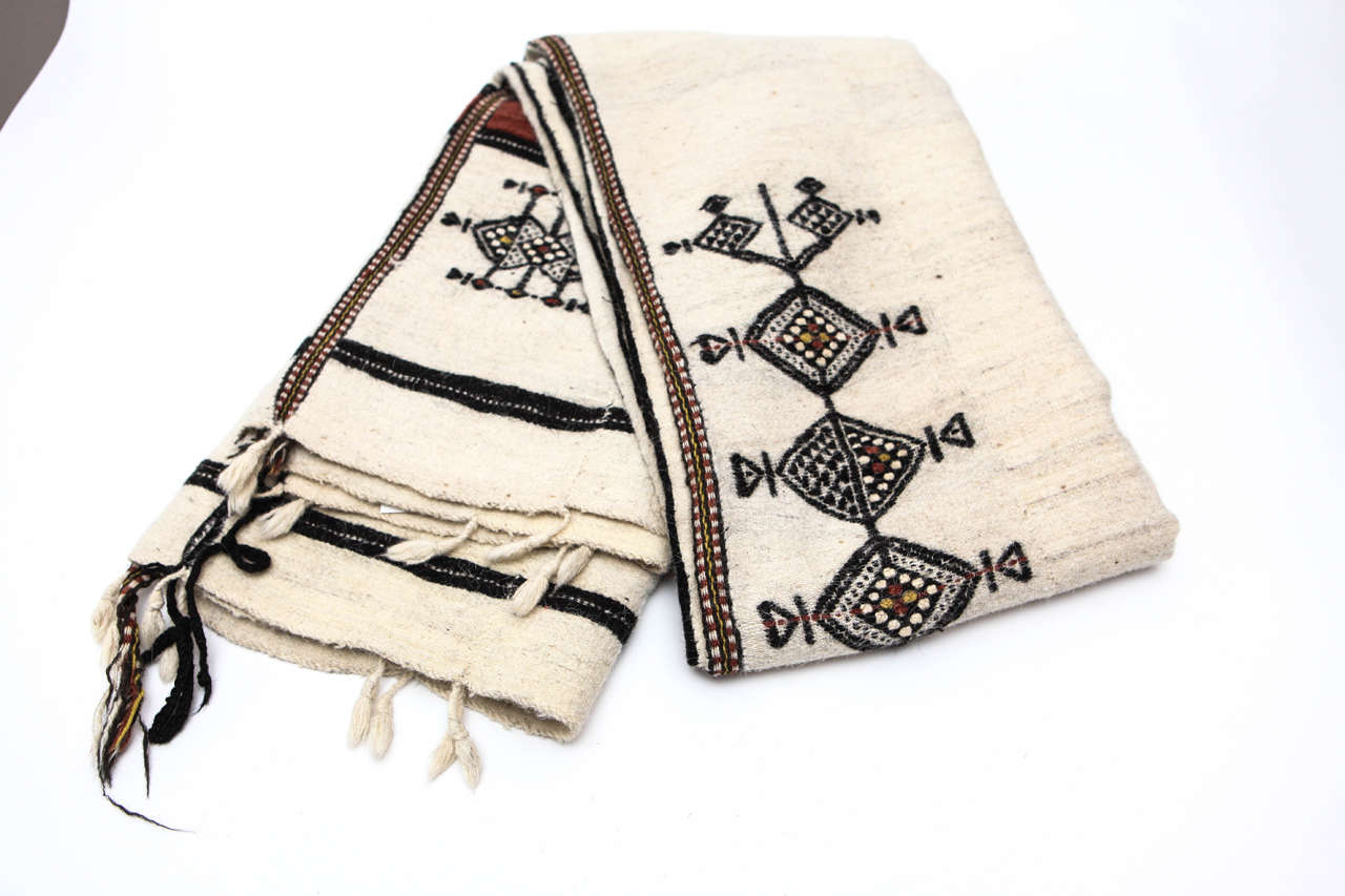 Traditional hand woven, brocaded blanket for Fulani tribal weddings (West, Central and Sudanese Africa). Made in two panels, white wool with brownish red and black handweave brocade.