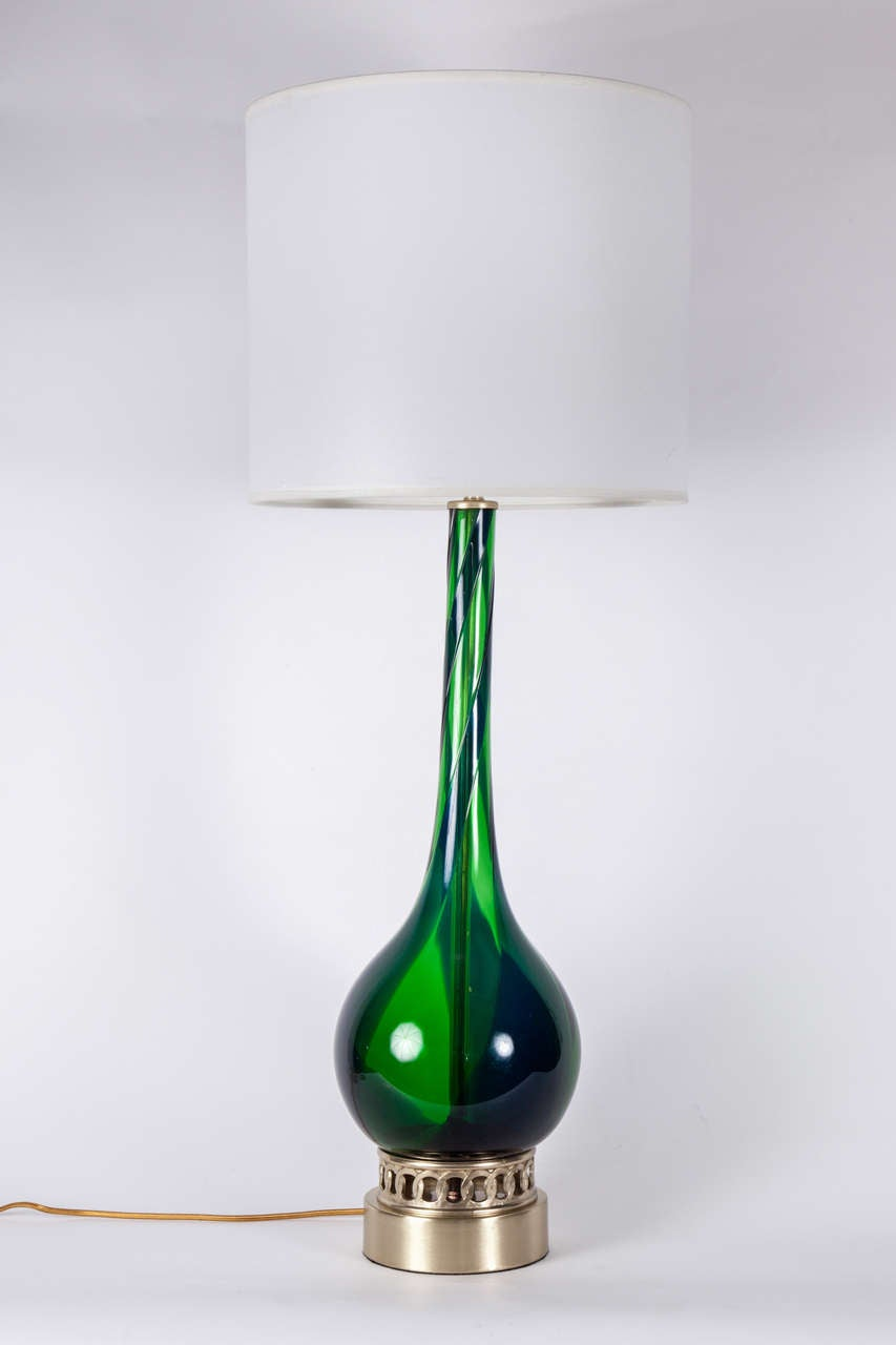 Striking  pair of Emerald Green Murano glass lamps with a dark blue glass spiral on satin brass bases. Rewired for use in the USA with brass hardware. Shades not included.