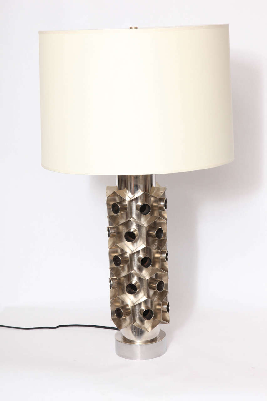 A 1960s Brutalist nickeled metal table lamp. Shade not included