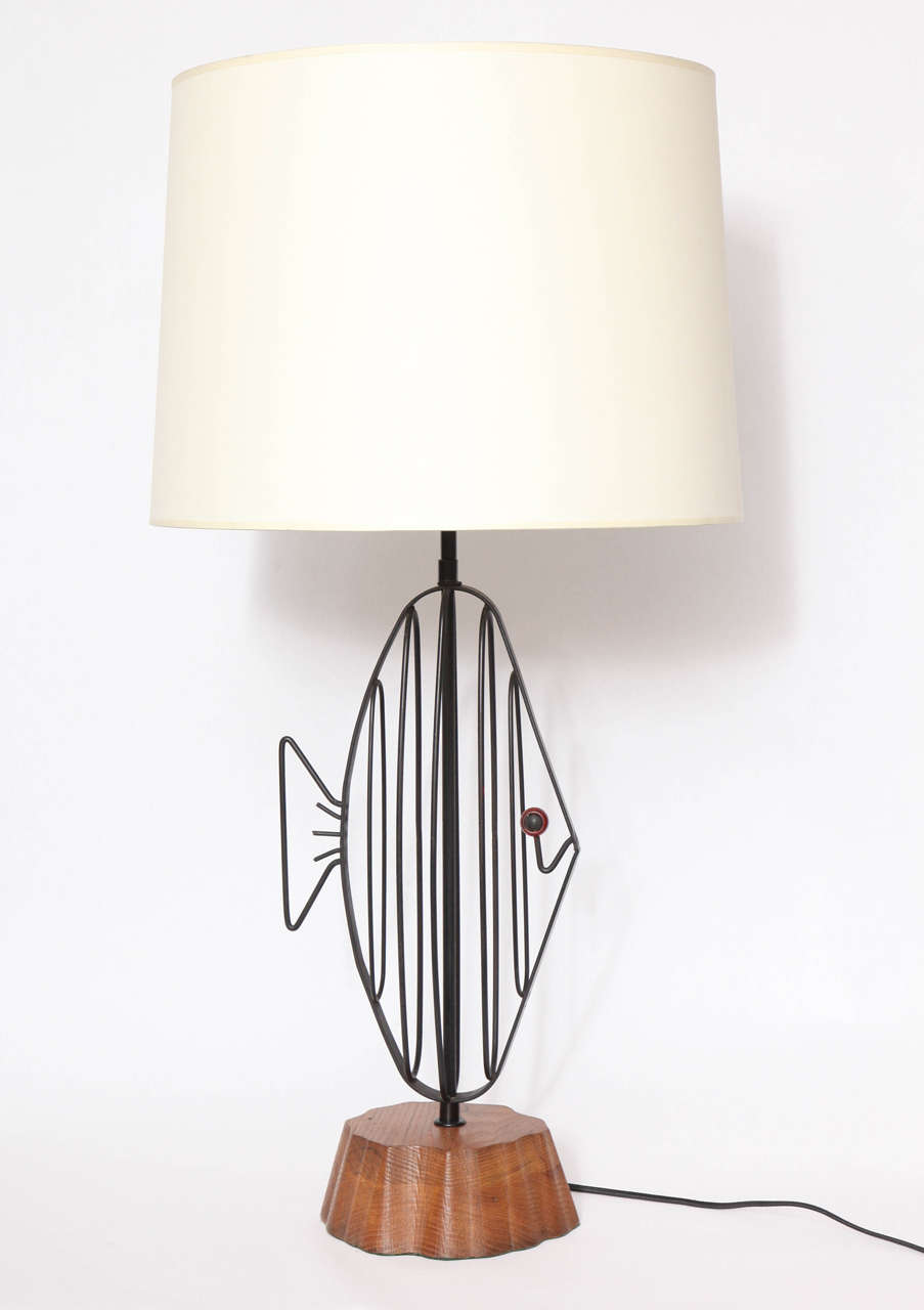 A 1950s handcrafted sculptural fish table lamp by Heifetz. Shade not included