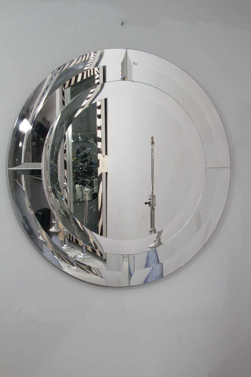 Round beveled clear mirror in quartered beveled mirror frame. Customization is available in different sizes.