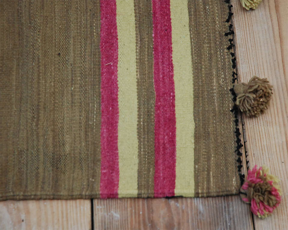 Small traditional Moroccan tapis style rug in citron, pink and light olive.