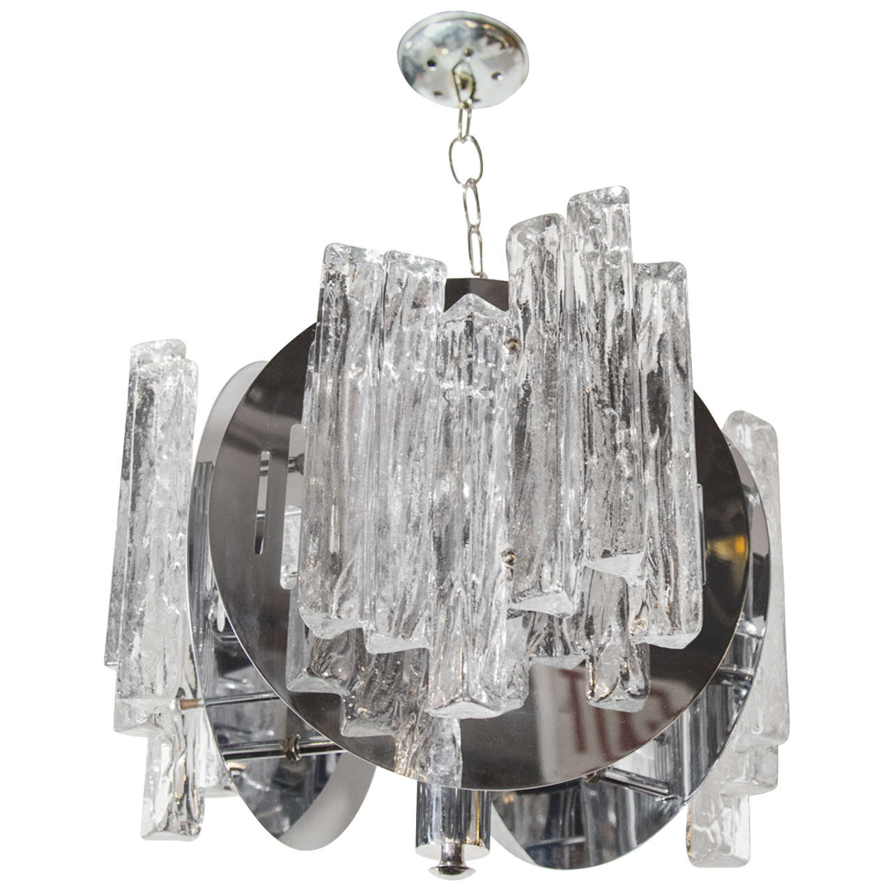 Mid-century modern trilateral chandelier with ice glass details. The fixture is comprised of a chrome frame with circular chrome discs. The discs have open slat details and are fitted with handblown textured ice glass. Adjustable chain height and
