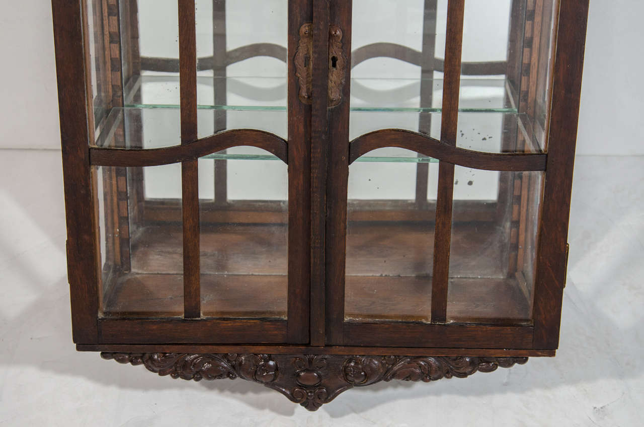 Hand-Carved Victorian Antique Curio Cabinet with Hand Carved Wood Designs For Sale