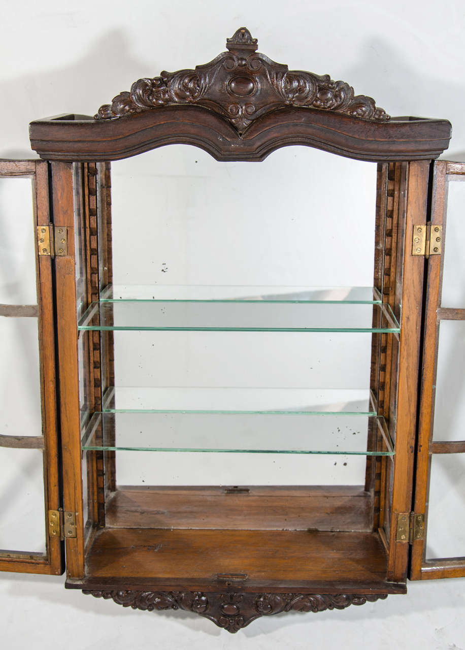 Glass Victorian Antique Curio Cabinet with Hand Carved Wood Designs For Sale