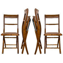 Set of Four Maple Wood Folding Chairs With Cane Seats
