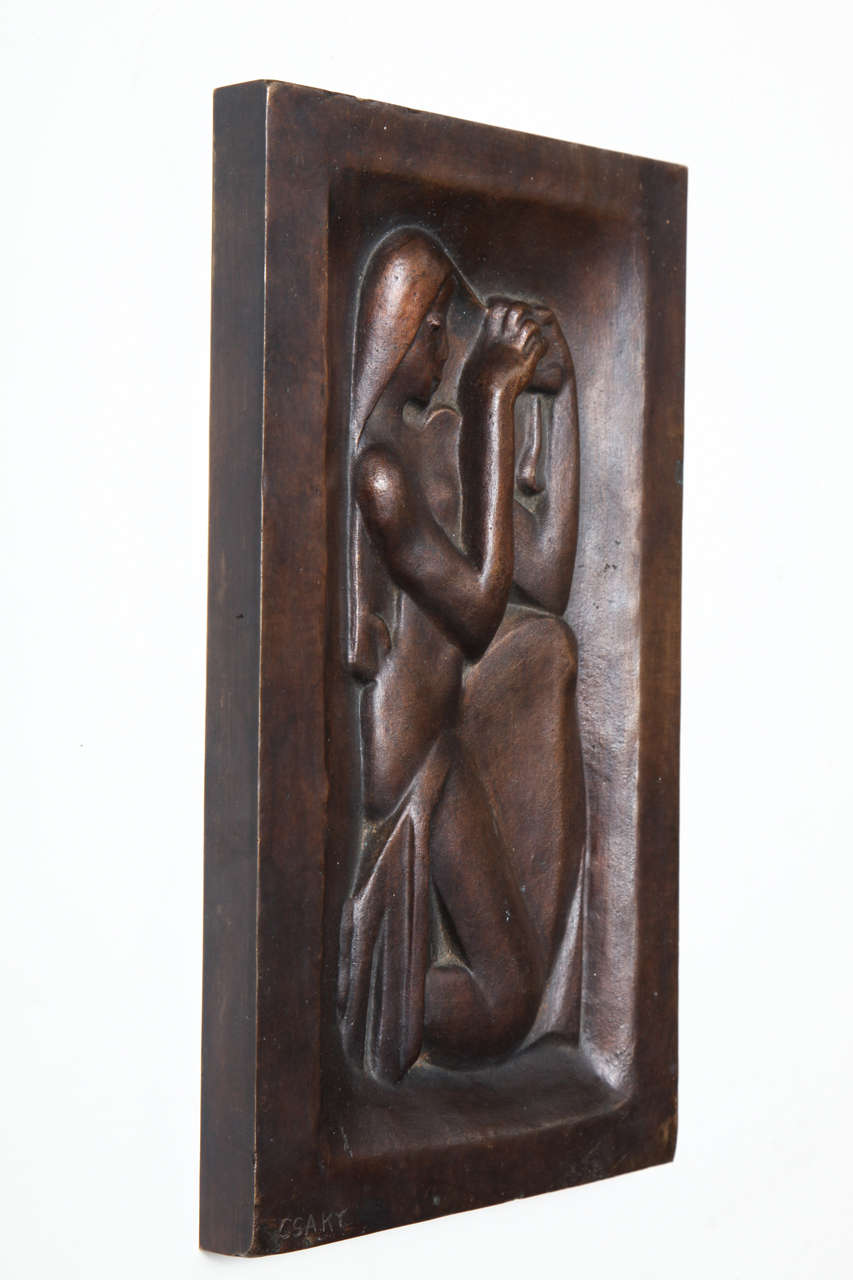 """Joseph Csaky """"Femme se peignant"""" (Woman combing her hair), brown patinated bronze relief, posthumous cast by Atelier Csaky, with Blanchet foundry stamp, numbered edition 4/8. Signed. 10.8"""" x 6.2"""" (27.5 x 16 cm). Reference: Felix"""