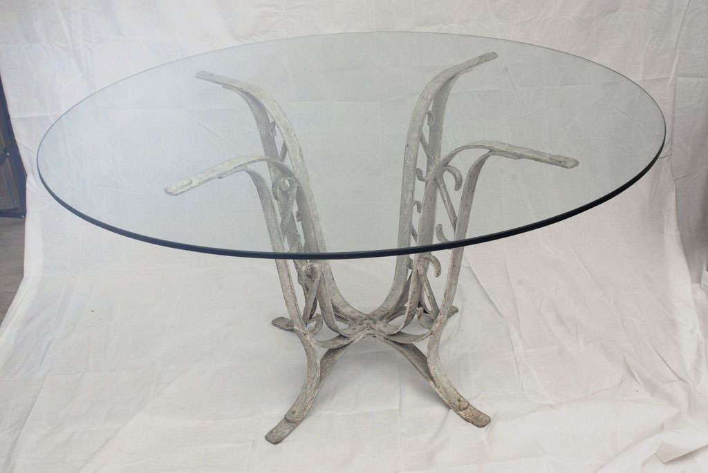 Grey painted cast iron base dining table with glass top at for Cast iron and glass dining table