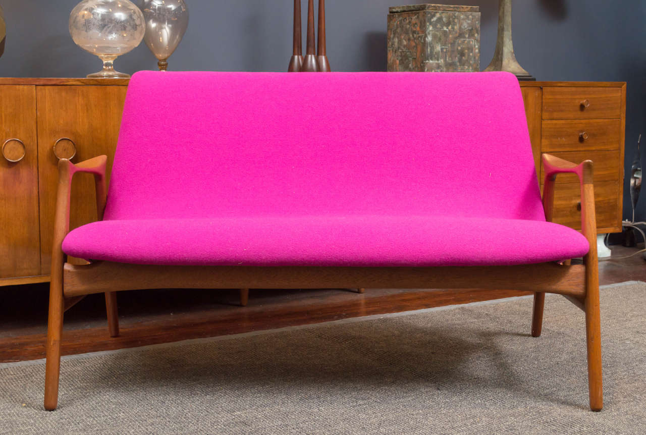 Hans Olsen design teak settee newly refinished and upholstered in Danish wool.  Perfect condition.