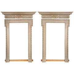 Pair of Door Surrounds and Pediments Framing Large Mirrors