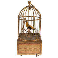 Vintage Mechanical Singing Bird in a Brass Cage, circa 1940s