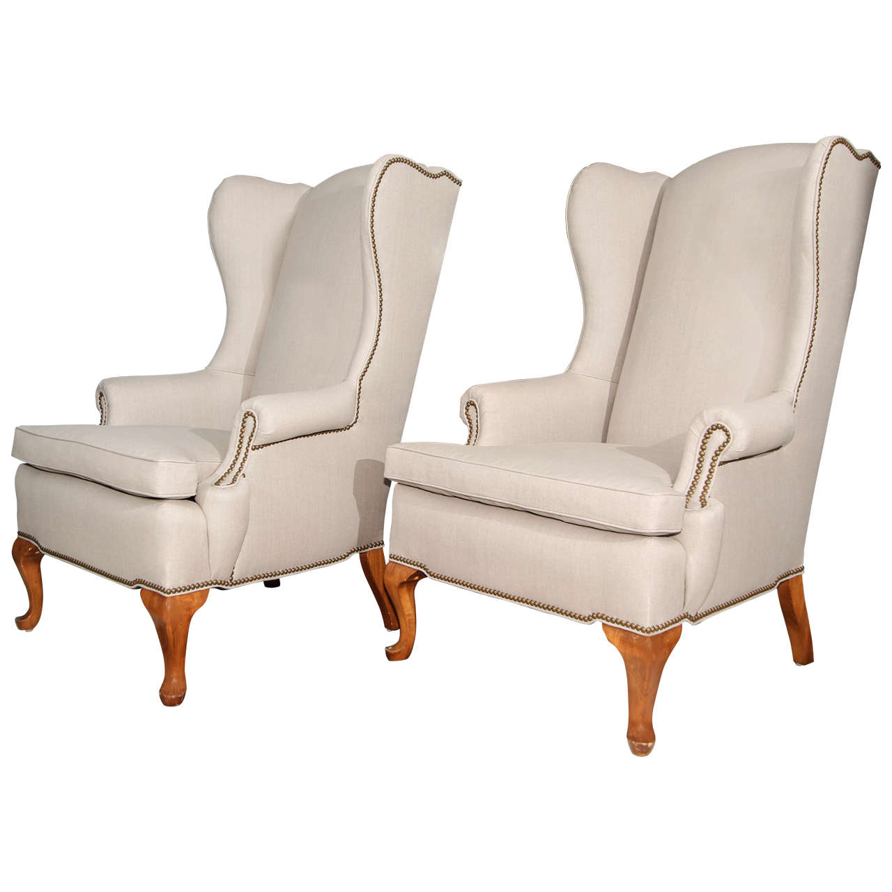 Pair Of Grey Linen And Nailhead Wing Chairs For Sale
