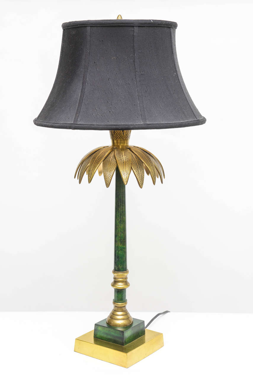 Original table lamp made by Wildwood of Rocky mount brass base and palm leaves. Metal column painted green/black. Original shade included. Three-way bulb 30-70-100W.