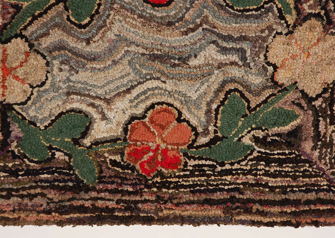 Fantastic geometric and floral hand hooked 19thc mounted rug ready for hanging. This wonderful floral hand hooked rug has a very geometric striped background and very folky flowers in a vine formation .The condition is very good minor wear in the