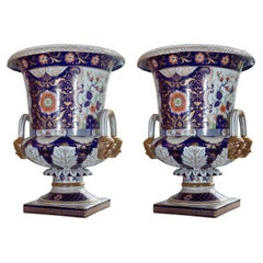 Magnificent Pair of Porcelain Urns