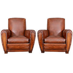 Pair of French Leather Club Chairs with Pleated Fronts