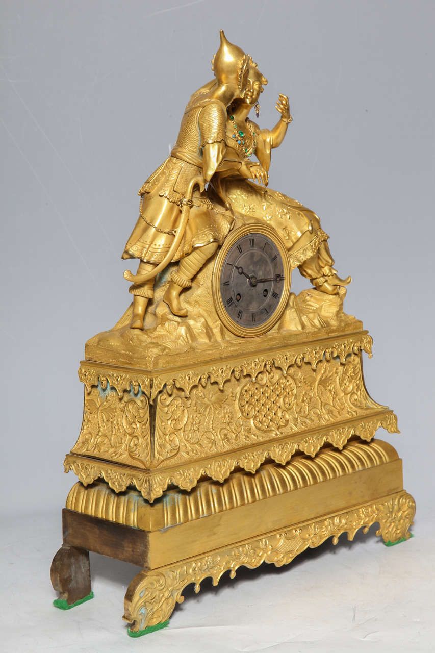 19th c. French Gilt Dore Bronze Chinoiserie Clock possibly made for the Chinese market. The intricately dressed figures are highly detailed with two toned gilding in both matte and varnished gold. The Lady is adorned in faux-emeralds, which gleam