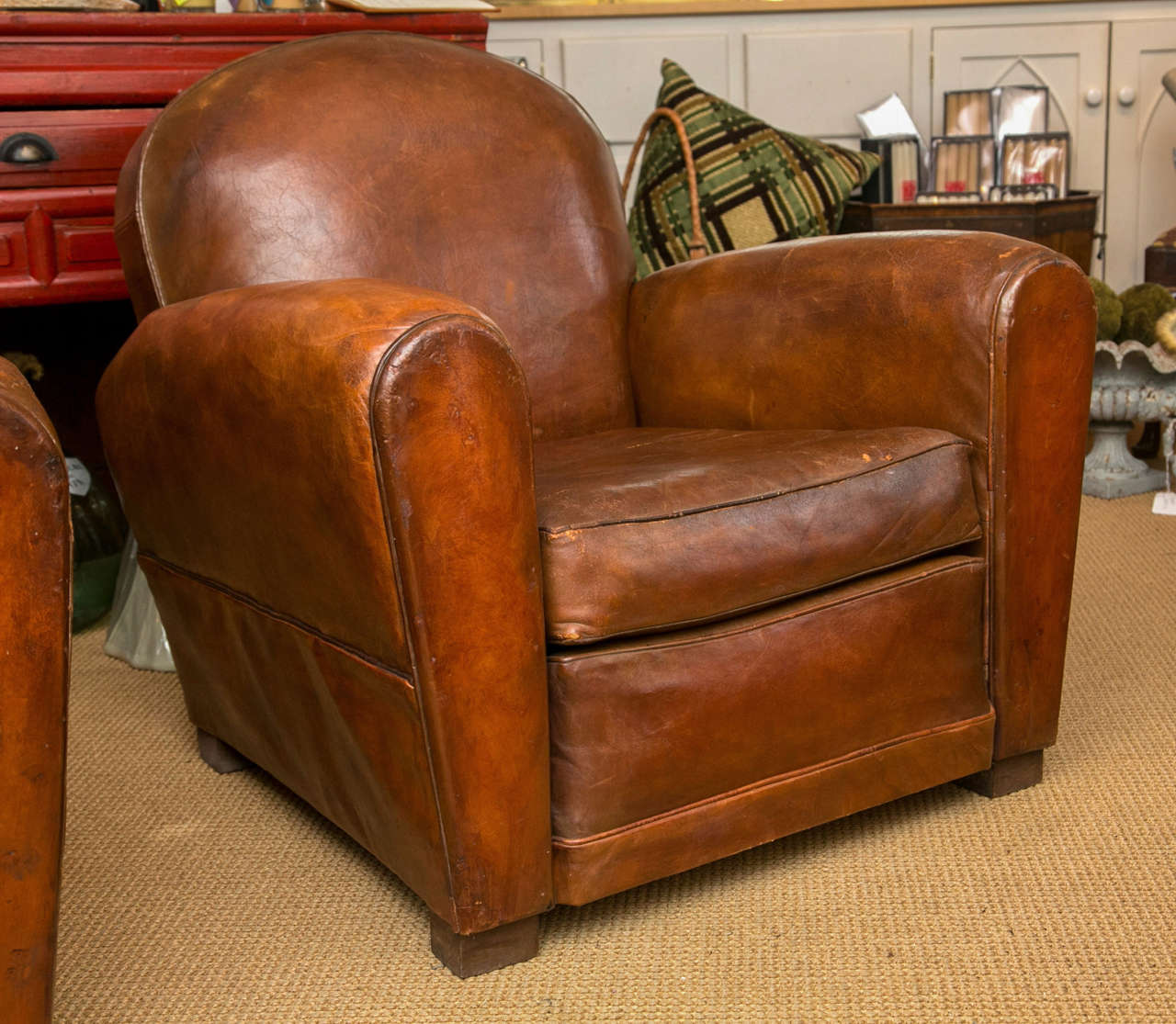 A Rounded Form Cognac Brown Leather Club Chair On Square Wooden Feet