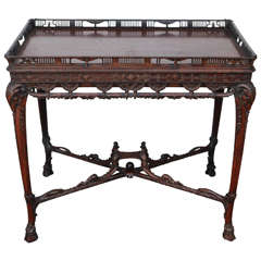 19th Century English Carved Mahogany Table with Stretcher