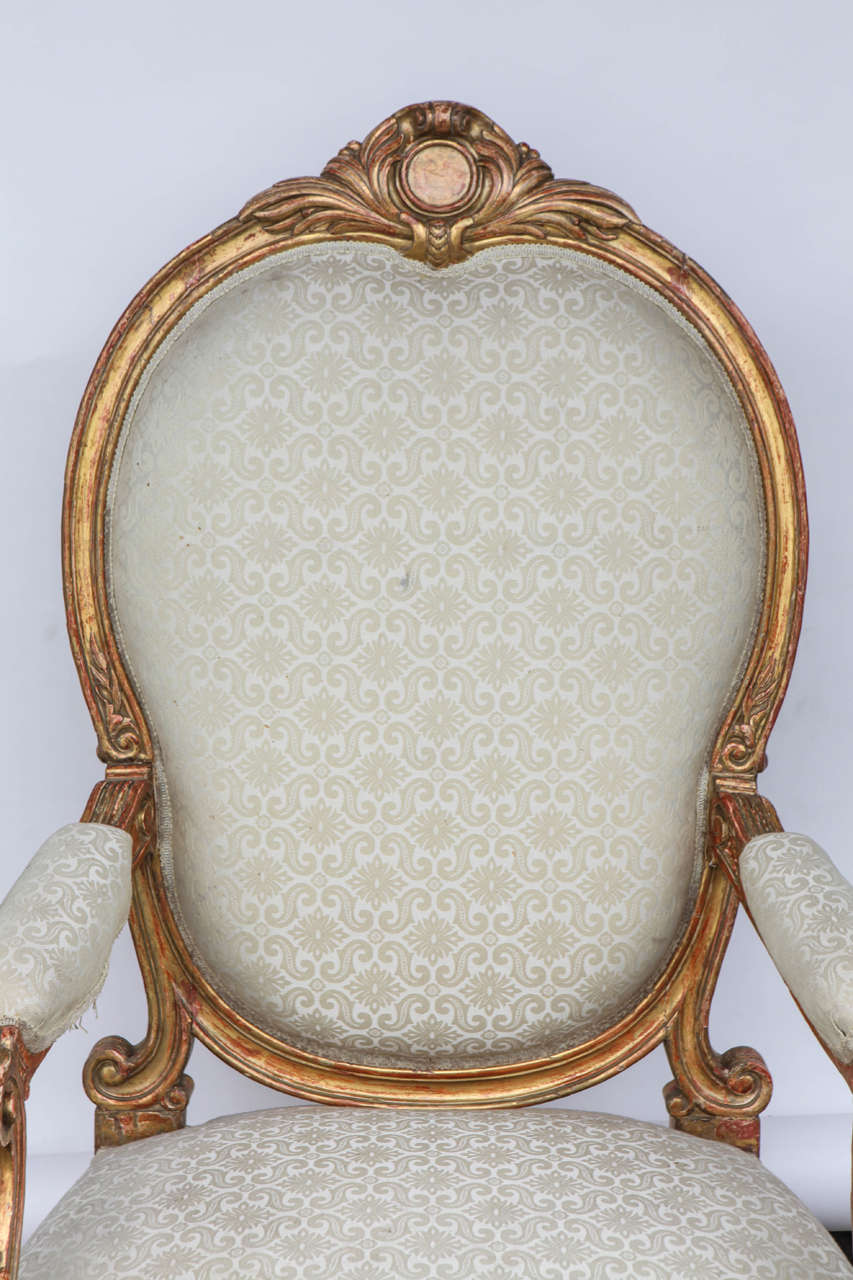 Carved Pair of 19th Century Italian Giltwood Oversized Balloon Back Armchairs For Sale