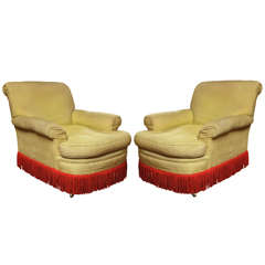 Pair of uphostered chairs with original fringe.