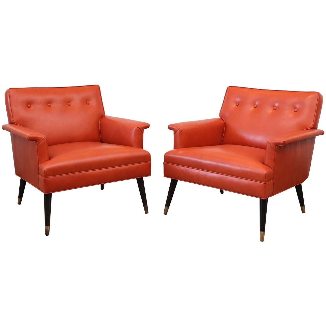 pair of orange leather mid century armchairs at 1stdibs