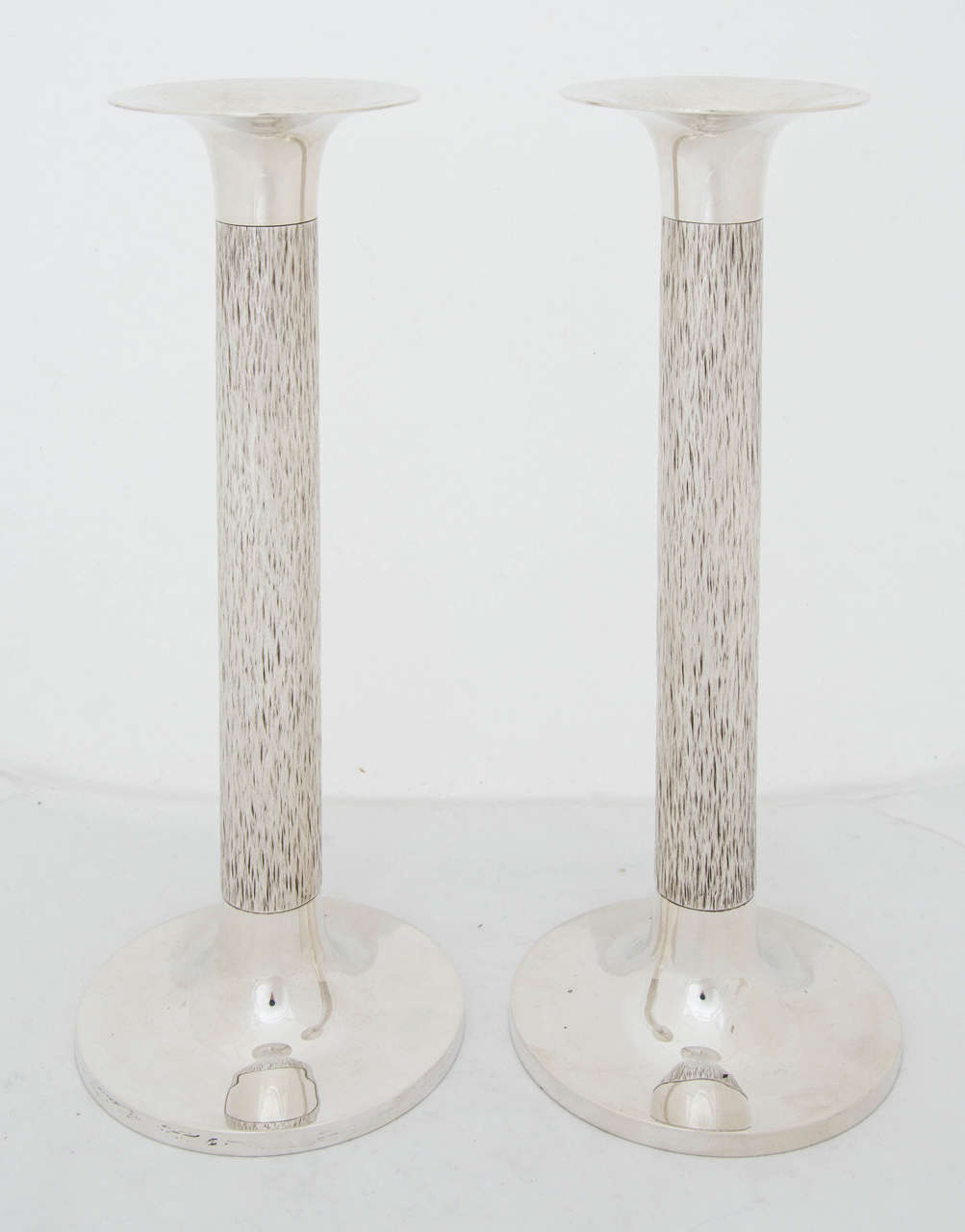A pair of sterling silver candlesticks made by the celebrated silversmith and designer Gerald Benney in London, 1969.