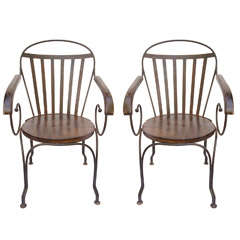 Great pair of antique iron arm chairs