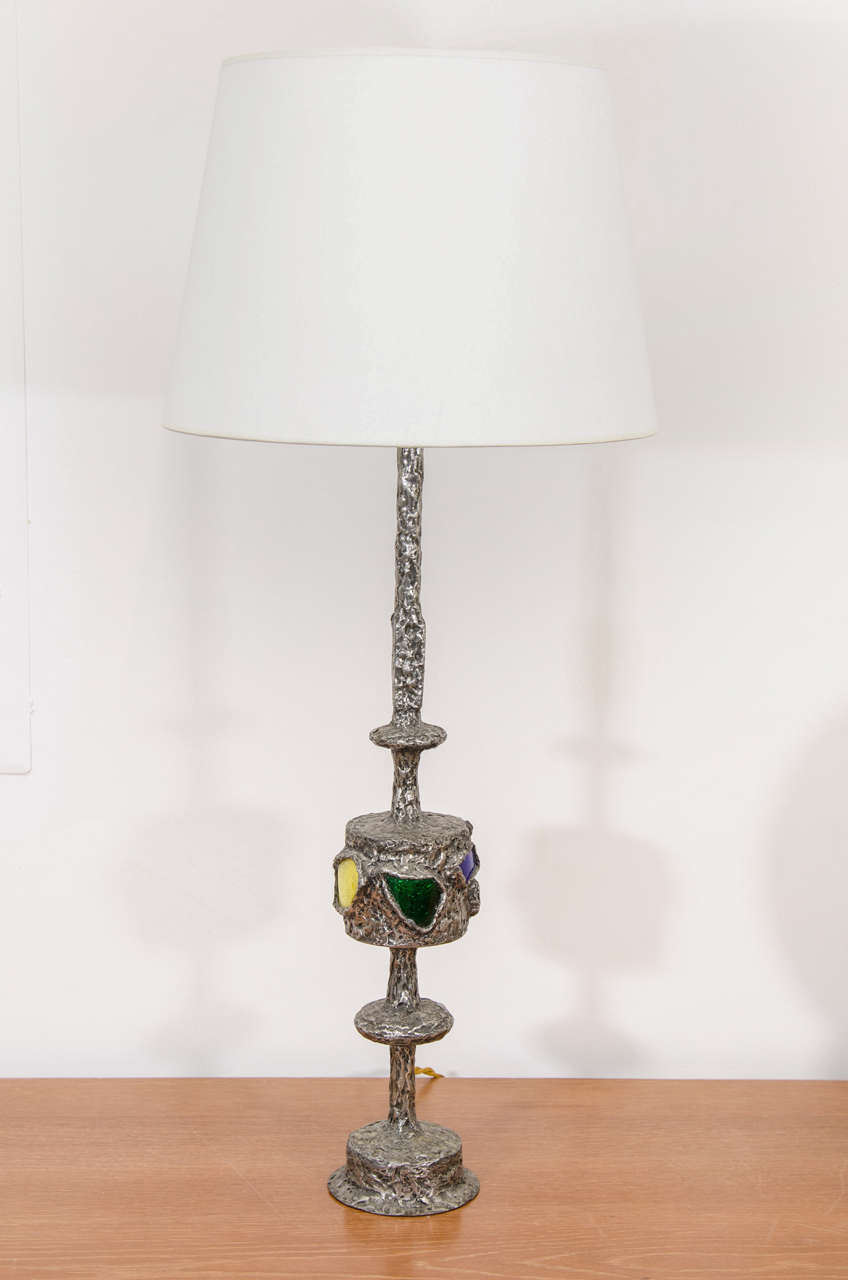 Metal and multicolored glass table lamp by artist Raymond Trameau. Handcrafted by the artist and signed.