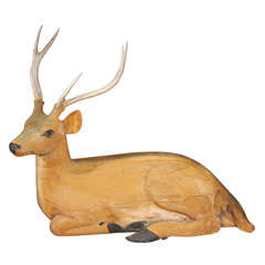 Reclining Carved and Painted Wood and Deer