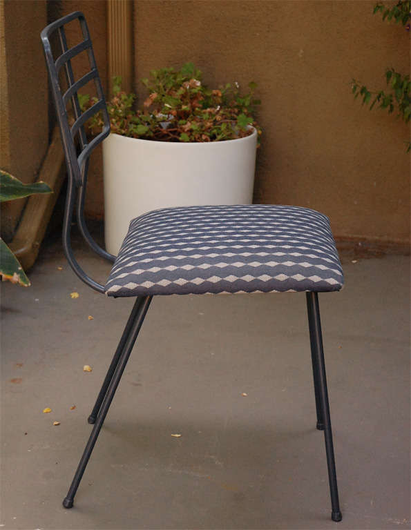 Metal and glass outdoor dining table and four chairs at for Metal patio table and 4 chairs