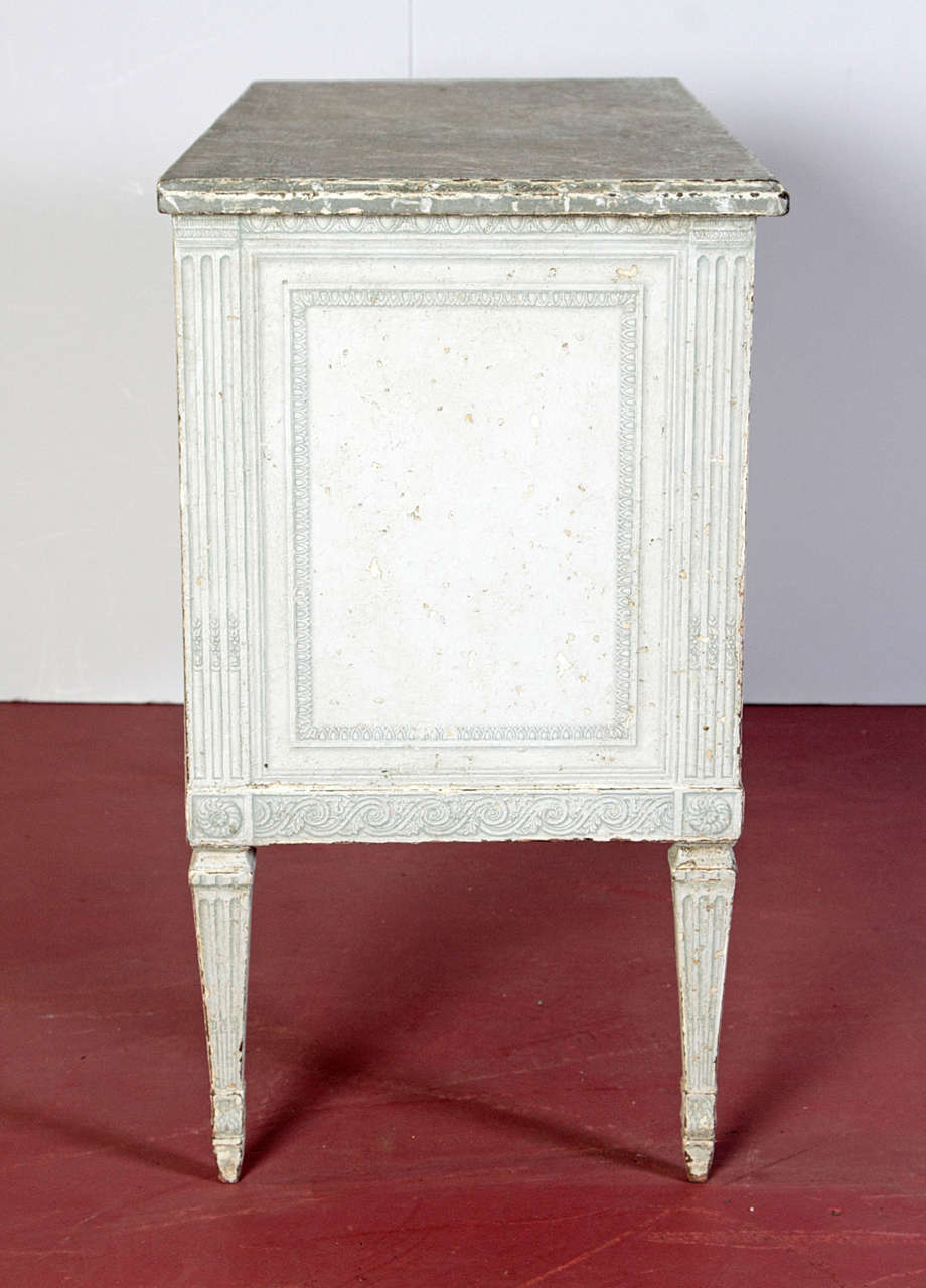 Place these antique two-drawer commodes as bedside tables in a master bedroom, or on either side of a mantel; crafted in northern France, circa 1880, each painted chest features a pair of drawers with hand-painted motifs across the front, and