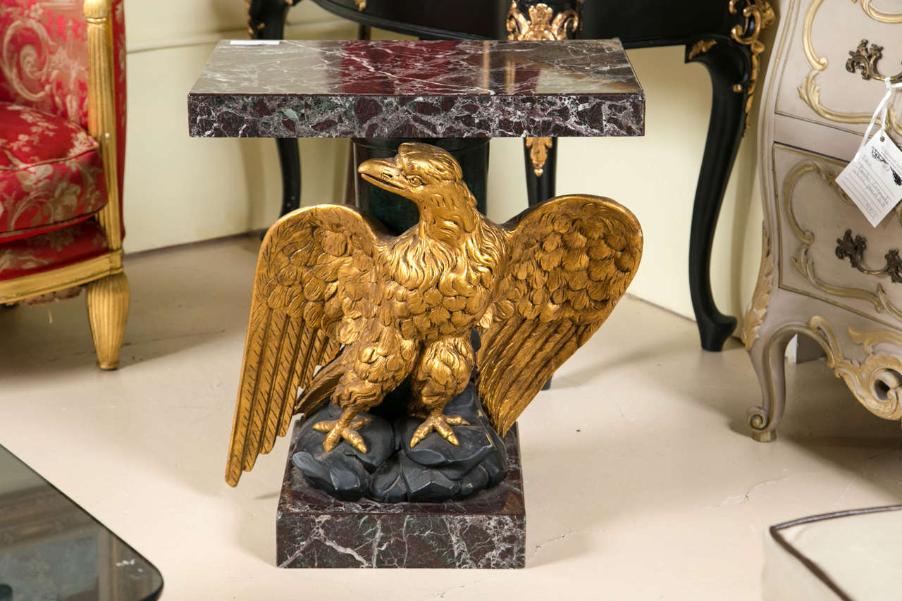 Federal style giltwood carved eagle pedestal table. Fabulous detail in this piece down to the Eagle's claws sitting on the rocks. A marble base matching the marble-top adds to this exquisite piece.