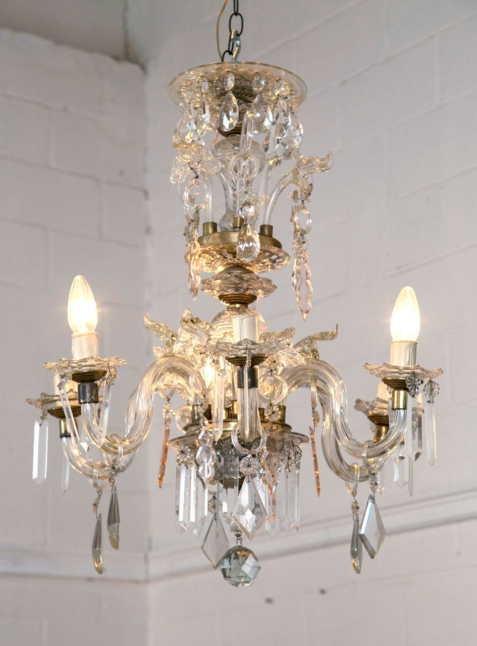 Venetian crystal chandelier with large crystals, vintage, 1900s, Argentina. Beautiful shimmering crystals with a touch of soft amber/rose to add a pop of soft color. This piece is reminiscent of the roaring 1920s. This six-light chandelier has