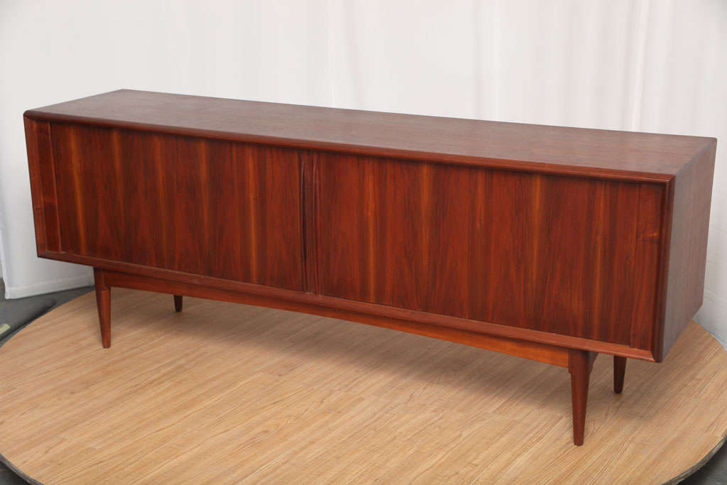 Beautiful, low-profile sideboard in walnut. The tambour doors are in great condition, materials and overall build quality are excellent.
