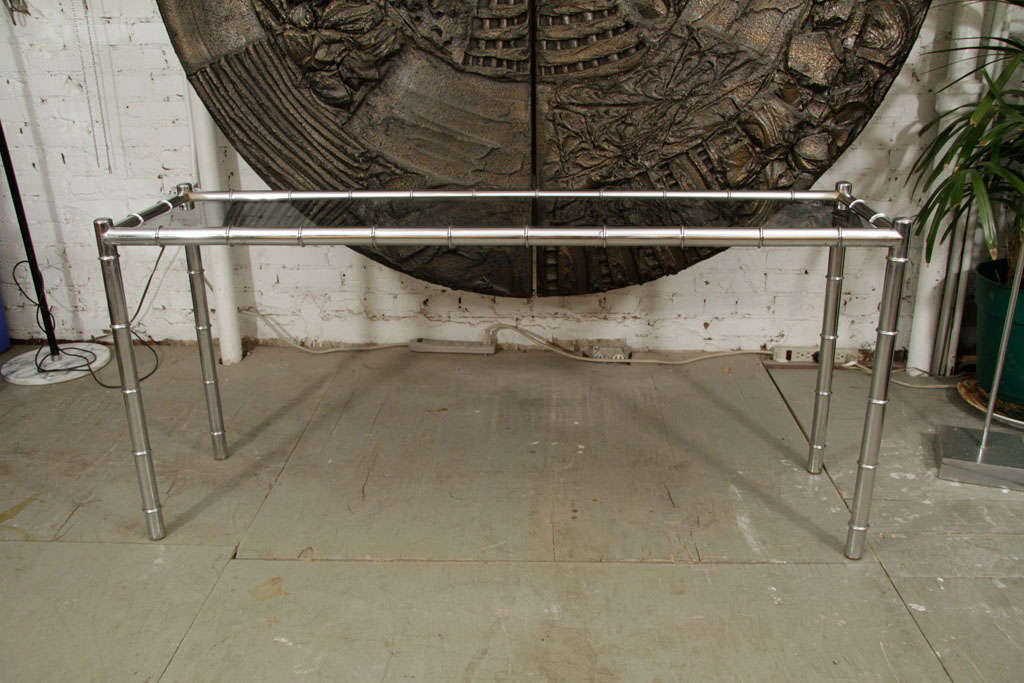 Charming and simple chrome table with a smoked glass top. Please contact for location.
