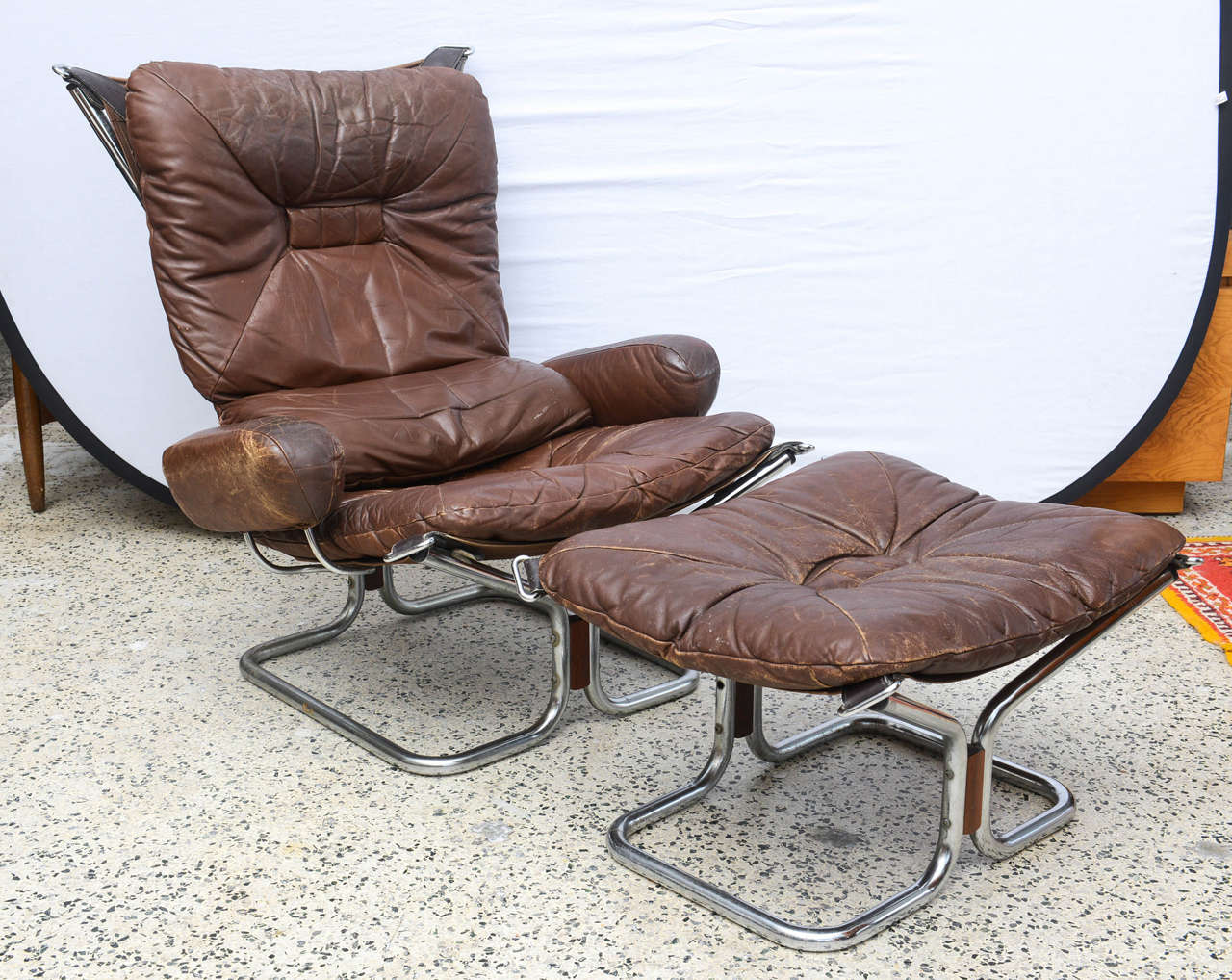 Wonderful vintage MCM chrome and leather with Rosewood accents chair and  ottoman by Ingmar Relling.  Norway 1970s.
