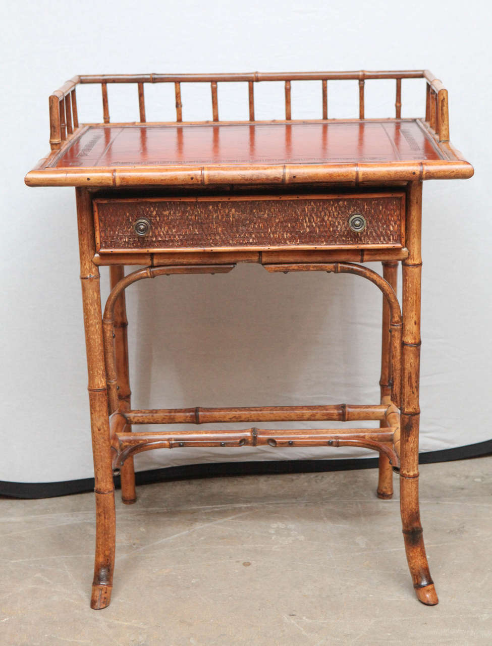 19th century English bamboo writing table with single drawer and tooled leather top. Can also be used as nightstand or end table.