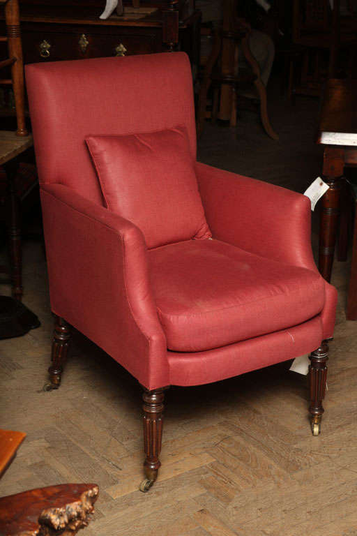 English upholstered armchair mahogany legs turned and fluted.