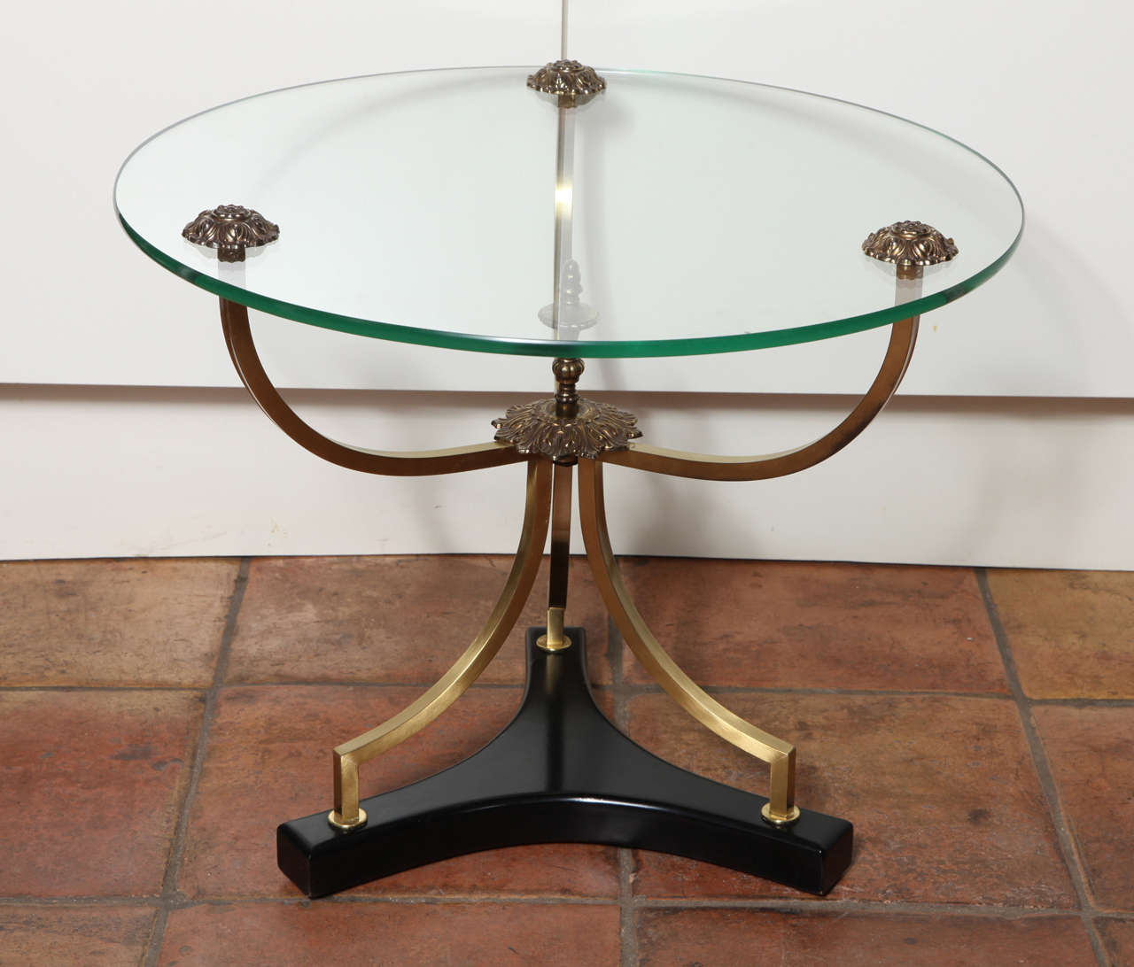 This gorgeous set of two Art Deco side tables that are light and low. They are perfect for a low sofa or low chair. The bronze base has flowers details at the glass top and in the center of the base. The T-shaped dark mahogany wood base with its