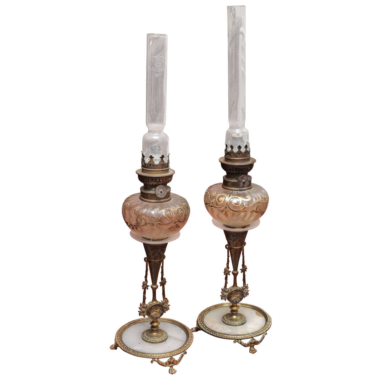 Pair of bronze and marble candle sticks with oil lamps at for Will oil paint stick to glass
