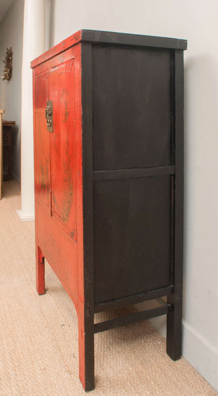 chinese red lacquer cabinet with gilt painting 19th