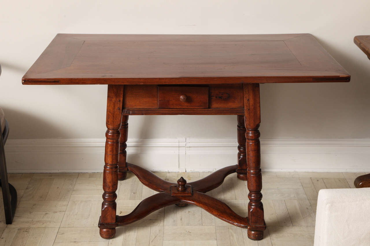 19th century mahogany centre table, one drawer in apron on turned legs joined by cross-stretchers, bun feet.