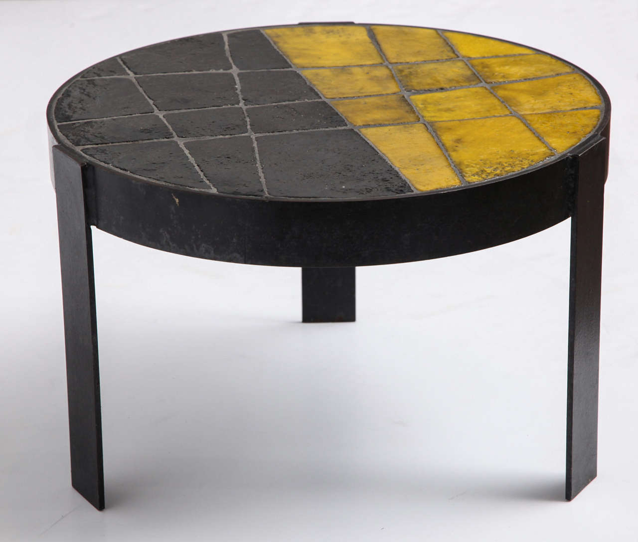 Glazed ceramic tile top table with patinated steel base