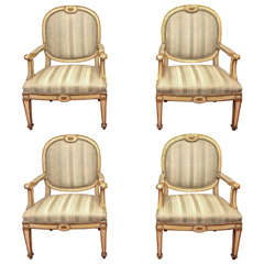 Four Italian Louis XVI Parcel Gilt and Painted Armchairs